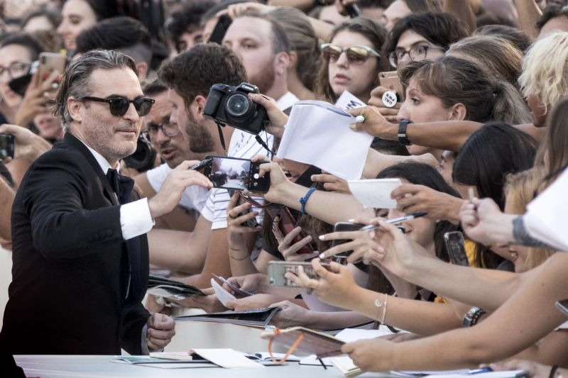 "VENICE, ITALY - AUGUST 31: Joaquin Phoenix walks the red carpet ahead of the ""Joker"" screening during the 76th Venice Film Festival at Sala Grande on August 31, 2019 in Venice, Italy. (Photo by Alessandra Benedetti - Corbis/Corbis via Getty Images)"