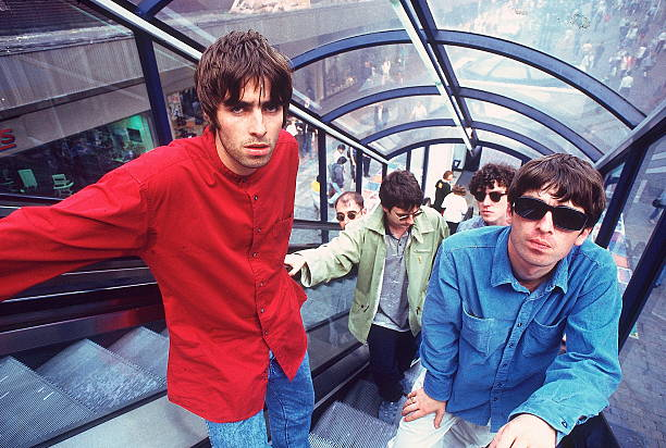 Oasis' Liam Gallagher, Paul 'Bonehead' Arthurs, Paul McGuigan, Tony McCarroll and Noel Gallagher in 1994