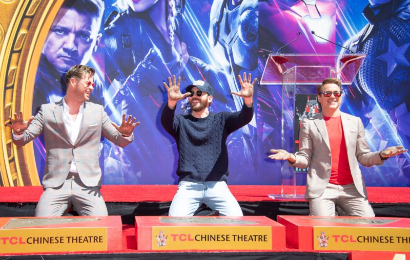 (L-R) Actors Chris Hemsworth, Chris Evans and Robert Downey Jr. attend the Marvel Studios' 'Avengers: Endgame' cast place their hand prints in cement at TCL Chinese Theatre IMAX Forecourt on April 23, 2019, in Hollywood, California. (Photo by VALERIE MACON / AFP) (Photo credit should read VALERIE MACON/AFP/Getty Images)