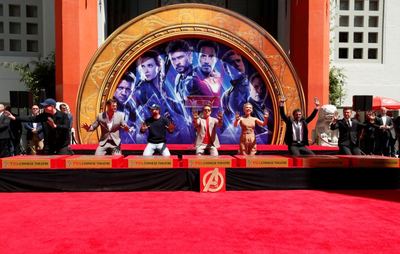 Actors Robert Downey Jr., Chris Evans, Mark Ruffalo, Chris Hemsworth, Scarlett Johansson, Jeremy Renner and Marvel Studios President Kevin Feige pose on the stage after placing their handprints in cement at a ceremony at the TCL Chinese Theatre in Hollywood, California, U.S. April 23, 2019. REUTERS/Mario Anzuoni