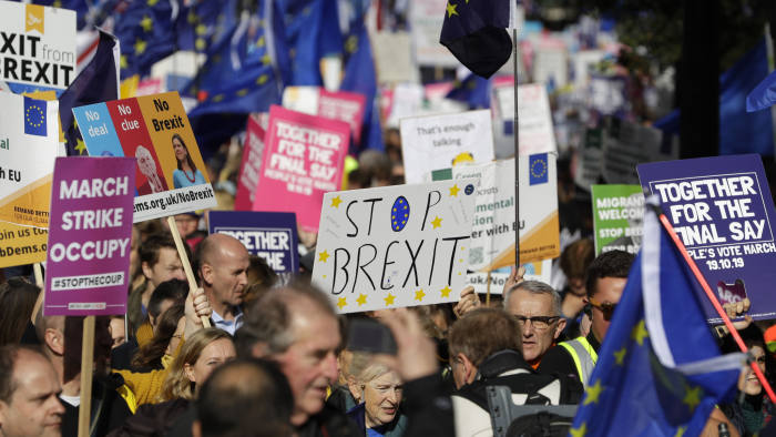 Anti-Brexit protestors march in London, Saturday, Oct. 19, 2019. Britain's Parliament is set to vote in a rare Saturday sitting on Prime Minister Boris Johnson's new deal with the European Union, a decisive moment in the prolonged bid to end the Brexit stalemate. Various scenarios may be put in motion by the vote. (AP Photo/Kirsty Wigglesworth)