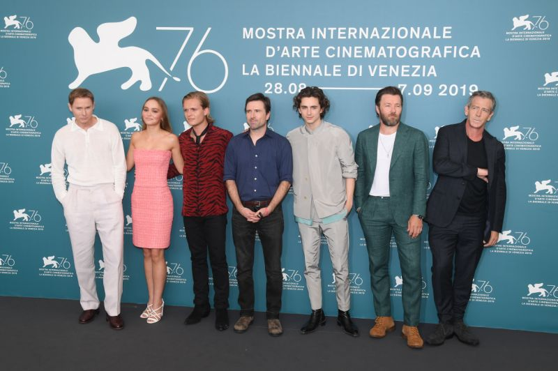 "VENICE, ITALY - SEPTEMBER 02: (L-R) Sean Harris, Lily-Rose Depp, Tom Glynn-Carney, Director David Michod, Timothee Chalamet, Joel Edgerton and Ben Mendelsohn attend ""The King"" photocall during the 76th Venice Film Festival at Sala Grande on September 02, 2019 in Venice, Italy. (Photo by Stephane Cardinale - Corbis/Corbis via Getty Images)"