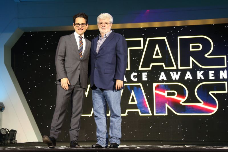 J.J. Abrams, left, and George Lucas pose for photographers upon arrival at the European premiere of the film 'Star Wars: The Force Awakens ' in London, Wednesday, Dec. 16, 2015. (Photo by Joel Ryan/Invision/AP)