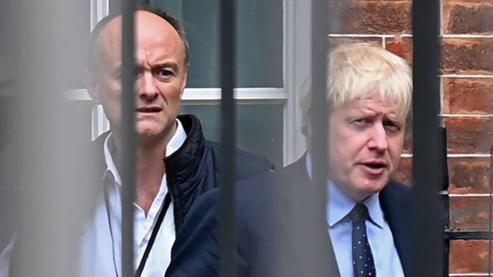 Britain's Prime Minister Boris Johnson (R) and his special advisor Dominic Cummings leave from the rear of Downing Street in central London on September 3, 2019, before heading to the Houses of Parliament. - The fate of Brexit hung in the balance on Tuesday as parliament prepared for an explosive showdown with Prime Minister Boris Johnson that could end in a snap election. Members of Johnson's own Conservative party are preparing to join opposition lawmakers in a vote to try to force a delay to Britain's exit from the European Union if he cannot secure a divorce deal with Brussels in the next few weeks. (Photo by DANIEL LEAL-OLIVAS / AFP) (Photo credit should read DANIEL LEAL-OLIVAS/AFP via Getty Images)