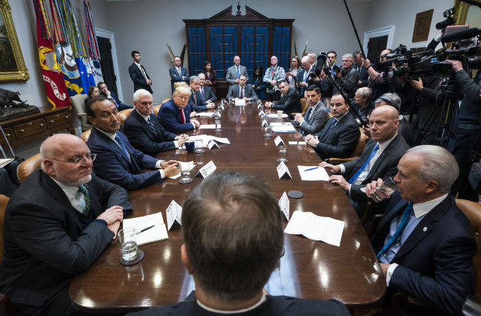 epa08269852 US President Donald J. Trump (C-L), along with Vice President Mike Pence, meets with airline CEO's to discuss the coronavirus outbreak in the Roosevelt Room of the White House in Washington, DC, USA, 04 March, 2020. Trump also spoke about Joe Biden's Super Tuesday success. EPA-EFE/JIM LO SCALZO